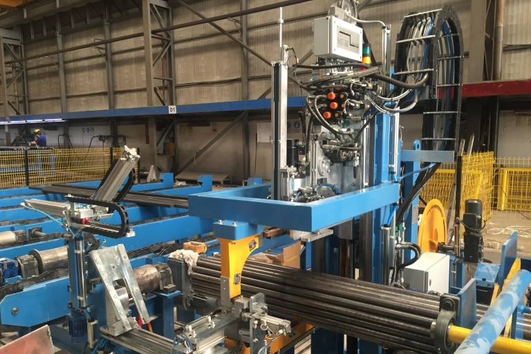 Automatic strapping machine for bars, plates and profiles